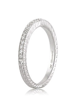 This elegant and detailed round diamond wedding band is a great compliment to any engagement ring or as a stand alone band. It features a row of round diamonds set halfway around the band in a beautiful pave setting. The rest of the band is hand engraved to perfection. The fine details are gorgeous!