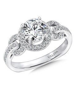 A spectacular round diamond halo is surrounded by circular links of diamonds in this modern design.  This engagement ring is part of the Modern Collection. Round halo mounting .22 ct. tw., 1 ct. round center. Price excludes center stone