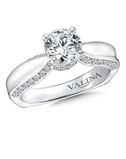 Ribbons of round diamonds decorate the sides of this classic engagement ring. Mounting with side stones .39 ct. tw., 1 ct. round center. Price excludes center stone