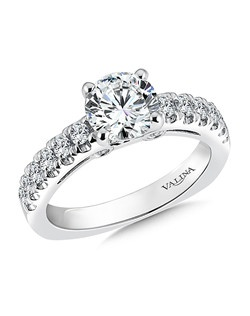 A band of larger diamonds frame the center stone in this classic design. Two diamonds set in the open gallery add a contemporary touch.Mounting with side stones .47 ct. tw., 1 1/4 ct. round center. Price excludes center stone