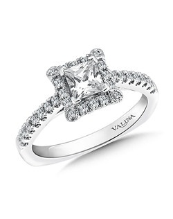 Dainty pear shape motifs soften the corners of the square shape diamond halo setting the stage for the Princess cut center. Cathedral diamond shoulders makes the whole ring shine. Square shape halo mounting  .28 ct. tw.,  1/2 ct. Princess cut center.Price excludes center stone