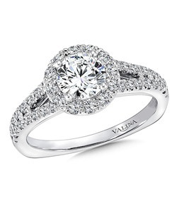 A delicate diamond split shoulder supports a dazzling round center stone in this classic halo design. Round halo mounting  .45 ct. tw.,  3/4 ct. round center.Price excludes center stone