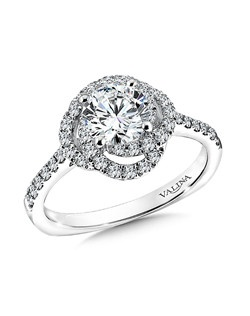 An open diamond spiral halo surrounds the center stone. A delicate band of diamonds cascades down the finger for simple elegance.  Mounting with side stones .37 ct. tw., 1 ct. round center.Price excludes center stone