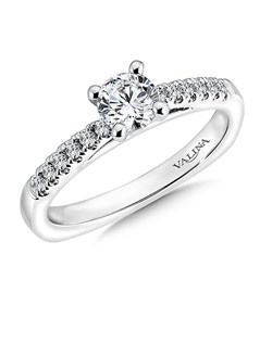 The raised fish tail-set shank sets the perfect stage for the dazzling center diamond in this classic solitaire ring design. Mounting with side stones .13 ct. tw., 1/2 ct. round center.Price excludes center stone