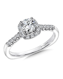 A sparkling band and delicate cushion shape halo lights up the center stone. A scalloped finger rest adds a unique touch. Cushion shape halo mounting .18 ct. tw., 1/2 ct. round center. Price excludes center stone