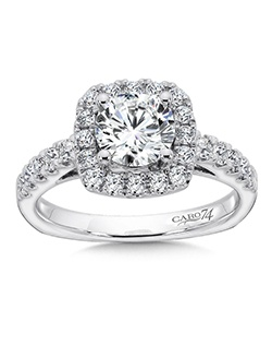 14K White Gold CARO 74 RING with platinum head. A round center stone with cushion shaped diamond halo. Elegant band with side diamonds and secret stones.   Also available in white gold, yellow gold, 18K and Platinum. Price excludes center stone