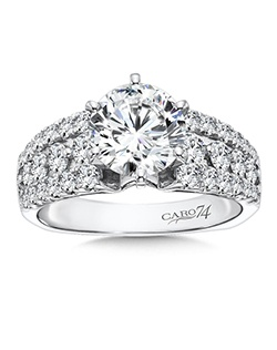 14K White Gold CARO 74 RING with platinum head. Three rows of spectacular diamonds with round center stone. Also available in white gold, yellow gold, 18K and Platinum. Price excludes center stone