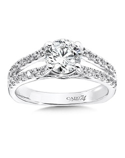 14K White Gold CARO 74 RING with platinum head. An elegant diamond split shank engagement ring with secret side stones and round center stone.  Also available in white gold, yellow gold, 18K and Platinum. Price excludes center stone