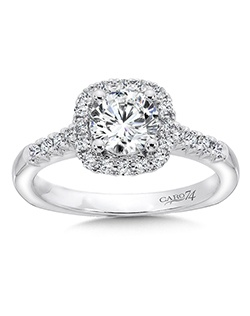 14K White Gold CARO 74 RING with platinum head. Diamond side stones accent round center stone with diamond halo in this classic design. Also available in white gold, yellow gold, 18K and Platinum. Price excludes center stone