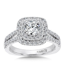14K White Gold CARO 74 RING with platinum head. Cushion shaped double halo surrounds round center stone supported by diamond split shank  and filigree detailing.   Also available in white gold, yellow gold, 18K and Platinum. Price excludes center stone