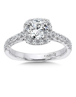 14K White Gold CARO 74 RING with platinum head. A cushion shaped diamond halo emphasizes the round diamond center stone.  Diamond side stones add sparkle for a glamous flair. Also available in white gold, yellow gold, 18K and Platinum. Price excludes center stone