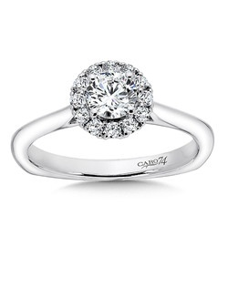 14K White Gold CARO 74 RING with platinum head. Smooth 14k white gold band with a round diamond halo and round diamond center stone. Also available in white gold, yellow gold, 18K and Platinum. Price excludes center stone