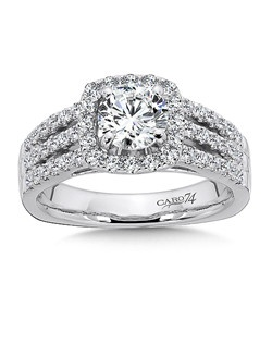 14K White Gold CARO 74 RING with platinum head. Diamond center stone is framed by a cushion shape halo.Three separate diamond strands cascade down the finger for a dramatic effect. Also available in white gold, yellow gold, 18K and Platinum. Price excludes center stone