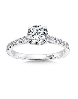 14K White Gold CARO 74 RING with platinum head. Diamond side stones embellish the shoulders of this classic solitaire diamond ring.  Also available in white gold, yellow gold, 18K and Platinum. Price excludes center stone