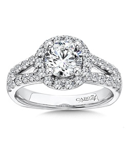 14K White Gold CARO 74 RING with platinum head. Two stands of separate sparkling diamonds meet at the center where a circular diamond halo frames the center stone.  Also available in white gold, yellow gold, 18K and Platinum. Price excludes center stone