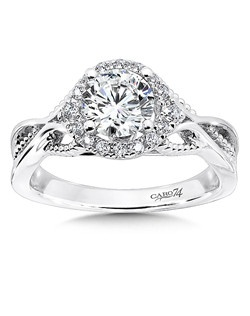 14K White Gold CARO 74 RING with platinum head. A strand of diamonds encircle the diamond center stone in this intricate design.  Stands of beaded and smooth white gold playfully interlace on the sides of the ring.    Also available in white gold, yellow gold, 18K and Platinum. Price excludes center stone
