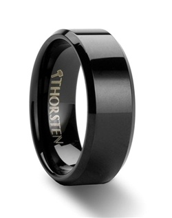 These Black Tungsten Rings have beveled edges for subtle character.  The shiny smooth black finish of each ring gives it a beautiful bold look.  Purchase the 4mm, 6mm, 8mm, 10mm and 12mm versions to have matching black wedding bands for him and her.  Larson Jewelers is proud to present our designer Black Tungsten Carbide Ring line by Thorsten. Please note, Black Tungsten Carbide rings are very durable, but can be scratched.  Truly Free Lifetime Sizing and Lifetime Warranty on all tungsten rings, no exchange|sizing fees, which are charged by other retailers.