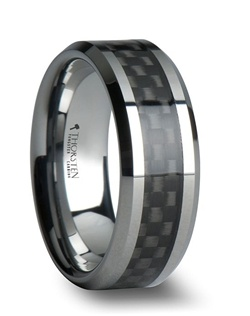 High tech carbon fiber is joined together with the durability of Tungsten Carbide in this line of Black Carbon Fiber Wedding Bands. This comfort fit wedding band is a flat style with beveled edges.   The black carbon fiber is inlaid seamlessly into the center and then an extremely scratch resistant resin is applied over it to protect the carbon fiber from wear.   This style comes in 4 mm, 6 mm, 8 mm, 10 mm and 12 mm, which is great for couples who want a matching set.  Larson Jewelers is proud to present our designer Tungsten Carbide Ring line by Thorsten.  Tungsten Carbide is extremely scratch resistant and are a great choice for those who want jewelry to be both maintenance free and worry free.  Truly Free Lifetime Sizing and Lifetime Warranty on all tungsten rings, no exchange|sizing fees, which are charged by our competitors.