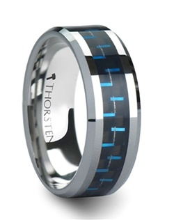 Exotic black and blue carbon fiber is inlaid into Tungsten Carbide with nickel binder to create this line of superior quality Comfort Fit Tungsten Carbide Rings by Thorsten Rings.  This ring is a flat style with beveled edges and is available in 6 mm & 8 mm for couples who prefer a matching set of tungsten wedding bands.  Larson Jewelers is proud to have the largest collection of cobalt free Carbon Fiber inlaid rings.  Tungsten Carbide is extremely scratch resistant and are a great choice for those who want jewelry to be both maintenance free and worry free.  Truly Free Lifetime Sizing and Lifetime Warranty on all tungsten rings, no exchange|sizing fees, which are charged by other retailers.