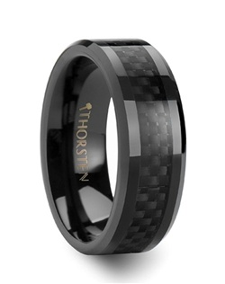 This awesome wedding band has the look of Black Tungsten Rings, but is a unique high tech combination of vibrant black carbon fiber and beautiful black ceramic.  This comfort-fit band is now available in 4 mm, 6 mm, 8 mm, 10 mm and 12 mm wide for couples who desire a matching wedding band set. The ring style has beveled edges and the black ceramic part of the ring is much more scratch resistant than black tungsten.  This is the perfect wedding band to represent your love and devotion.   Truly Free Lifetime Sizing and Lifetime Warranty on all tungsten rings, no exchange|sizing fees, which are charged by other retailers.