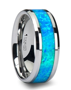 This exotic Comfort Fit tungsten inlay ring style is made of jewelry grade tungsten carbide that contains no cobalt.  The ring has polished beveled edges and has an inlay of beautiful laboratory grown blue/green opal.  This beautiful style comes in 6 mm, 8 mm, and 10 mm, which is great for couples who prefer a matching set tungsten wedding bands. Tungsten Carbide is the newest and strongest metal to be used in jewelry, ideal for men and women who are tired of rings that scratch easily.  Please note, inlay is made of a softer material than tungsten and can scratch. Truly Free Lifetime Sizing and Lifetime Warranty on all tungsten rings, no exchange|sizing fees, which are charged by other retailers.