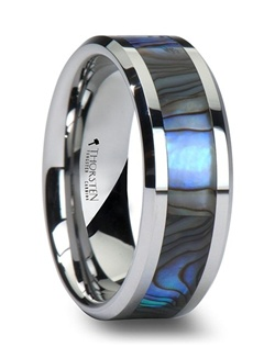 This unique comfort fit style from our tungsten rings collection is made of jewelry grade tungsten carbide with nickel binder, and contains no cobalt.  The ring has polished beveled edges and has an inlay of beautiful mother of pearl, which has purple, blue, green, white and black colors swirling together like the waves in the ocean.  Mother of pearl is a decorative material that has been used for centuries on furniture, musical instruments, and jewelry. It is made from the inside lining of oyster shells and abalone shells. This style is available in 6 mm and 8 mm for couples who want a matching set. Please note this material is not as strong as tungsten and can chip if ring is dropped. Tungsten Carbide is the newest and strongest metal to be used in jewelry, ideal for men and women who are tired of rings that scratch easily Truly Free Lifetime Sizing and Lifetime Warranty on all tungsten rings, no exchange|sizing fees, which are charged by other retailers.