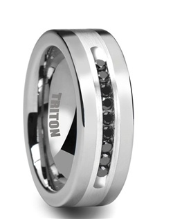 This very elegant Triton ring features 9 black diamonds that are set into a channel in the silver inlay. The edges of this ring are polished to a high shine that creates excellent contrast to the brushed silver inlay.   Total diamond weight is 1/4 carat.  This is the perfect wedding ring to show the world your love and commitment. Larson Jewelers is proud to be an authorized dealer of Triton Rings. Triton Rings is one of the most well known and respected designers of tungsten rings in the USA. All their rings come with a manufacturer's warranty that covers size exchanges for life, and repair or replacement in case of accidental damage. Note: There is a fee charged by Triton Rings, not us, for all warranty work to cover shipping and handling.