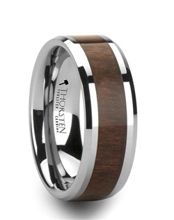 This rare tungsten and wood inlay style from our wood inlay rings line is made of tough tungsten and beautiful black walnut wood.  This design brings together the most scratch resistant material and the oldest material to be used in jewelry. The inlay is made of real black walnut wood.  You can tell by the grain of the wood going from side to side.  If the grain runs around the ring, this is an indication of fake wood, because real wood can't be bent around the ring against the grain.  This comfort-fit band has beveled edges and is available in 6 mm, 8 mm, and 10 mm wide, for couples who desire a matching set.  This is the perfect wedding band to represent your love and commitment.  Note, inlay is protected by a resin that can be scratched.   Truly Free Lifetime Sizing and Lifetime Warranty on all tungsten rings, no exchange|sizing fees, which are charged by our competitors.