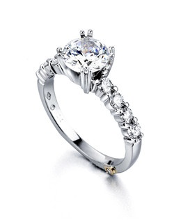 The Reflection ring contains 9 diamonds, totaling 0.405ctw. Shown with a 1ct center diamond. Center stone sold separately, not included in price. Available in yellow, white, or rose gold, and platinum. Rings can be custom made to fit any size or shape diamond or color center stone. Price excludes center stone
