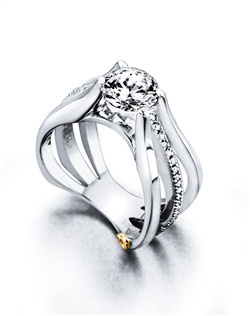 The Starfire engagement ring contains 33 diamonds, totaling 0.165ctw. Shown with a 1ct center diamond. Center stone sold separately, not included in price. Available in yellow, white, or rose gold, and platinum. Rings can be custom made to fit any size or shape diamond or color center stone. Price excludes center stone