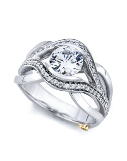 The Sublime engagement ring contains 58 diamonds, totaling 0.25ctw. Shown with a 1ct center diamond. Center stone sold separately, not included in price. Available in yellow, white, or rose gold, and platinum. Rings can be custom made to fit any size or shape diamond or color center stone. Price excludes center stone