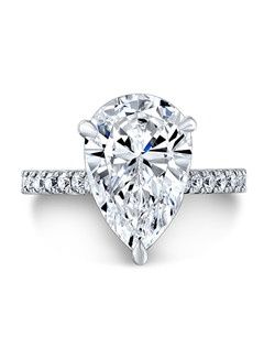 Pear-shaped center diamond, 3.84 carats H/SI1 GIA; side diamond, .45tcw; in platinum setting