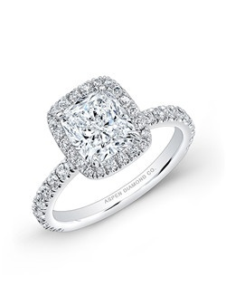 Cushion cut diamond, 1.60 carats, with pave; total weight .70 carats; platinum setting