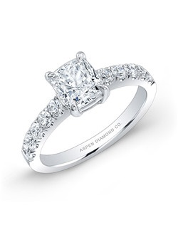 Cushion cut diamond, 1.00 carats D VS2, with side diamond; total weight .70 carats; platinum setting