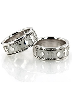 A gorgeous Christian design! This 8.5mm wide Religious wedding ring set has beautifully carved crosses evenly spaced all around the center. The handmade design is complete with two small braids on each side and shiny edges. This wedding band is also available in 9.5, 10.5, 11.5. Center of the band is high polished, with a matte background. Small braids and each side are also high polished.