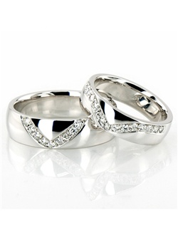 Lovely V shape channel set his & hers set. His ring is 6mm wide and set with 9 Round Brilliant Cut Diamonds. Each diamond weighs 0.015ct, total 0.135ct. Her ring is 5mm wide and set with 15 Round Brilliant Cut Diamonds. Each diamond weighs 0.015ct, total 0.225ct. The diamonds are graded G in color and SI1 in clarity. The band is high polished.