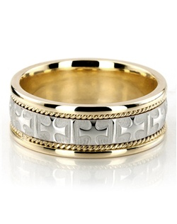 A masterpiece among religious wedding bands, this 8mm Two-tone Handmade wedding ring is a besteller for good reason! With the cross designs and small braids at each side, this band is a favorite of lovers of religious styles. Center of the band is White Gold. Crosses and rectangles are high polished, with a sandblast finish background. Small braids and edges are Yellow Gold and high polished.