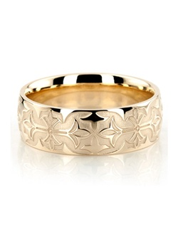 Simply flawless! This 8mm wide Fancy Grooved wedding band has an exclusive embossed center pattern. Center background is glass bead finished. Embossed design and edges are high polished.