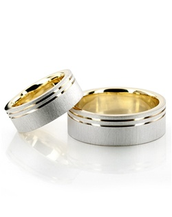 A very modern design, this 6mm wide wedding ring set has two parallel bright cuts close to one of the edges. Center of the band is brush finished. Parallel bright cuts are high polished.