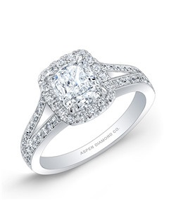 Cushion cut center diamond, 1.30 carat; diamond side stone total carat weight, .40 carats; 18K white gold setting
