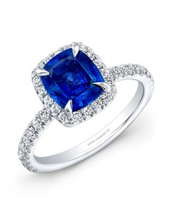 Cushion sapphire center, 1.58 carats; with round brilliant diamond micropave total carat weight .65; platinum setting