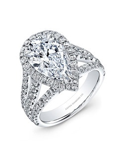 Pear shaped diamond, 5 carats, with pavé; total weight 1.50 carats; platinum setting
