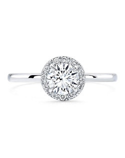 Round brilliant diamond, .75 carats, with pavé halo; total weight .25 carats; platinum setting