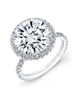 Round brilliant diamond, 6.55 carats, with micropavé; total weight 7.3 carats; platinum setting
