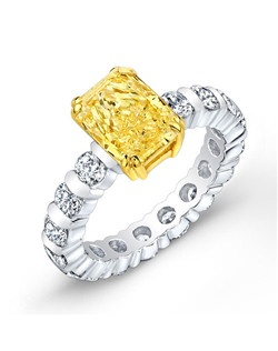 Radiant-cut yellow diamond, 3.21 carats; round diamonds 3.20 carats; platinum setting