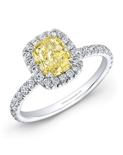 Cuchion-cut fancy yellow diamond, 1.02 carats; diamond total carat weight, .65 carats; 18k white gold setting
