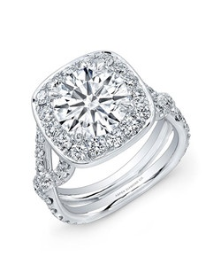 Round Brilliant Diamond, 3.15 carats; side diamond total carat weight, 1.25 carats; platinum setting