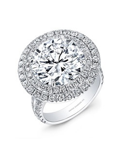 Round Brilliant diamond, 6.76 carats; with double pave halo; 1.25 total carat weight; platinum setting