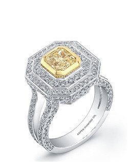 Yellow diamond, 1 carats; diamond, 1.65 carats; 18k white gold setting