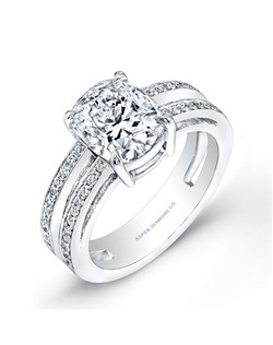 Round brilliant diamond, 1.50 carats, with micropavé; total weight 2.10 carats; platinum setting
